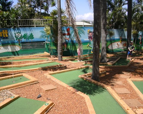 A putt putt golf course surrounded by trees.