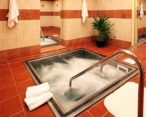A well furnished indoor hot tub.
