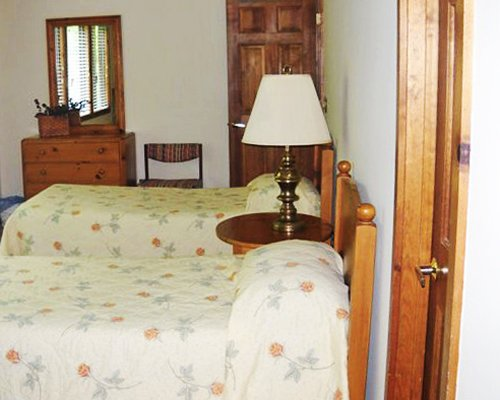 An open plan bedroom with two twin beds.