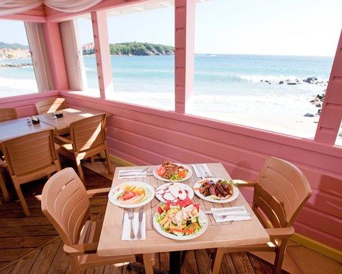 Balcony with a dining area alongside the beach.