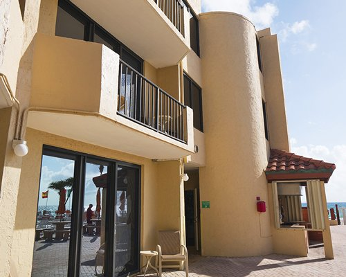 Exterior view of the Costa del Sol Resort with patio furniture.