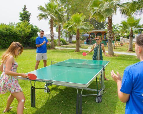 People playing outdoor ping pong.