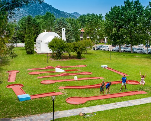 People playing in an outdoor mini golf course at the resort.