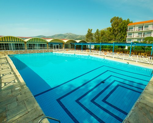 A large outdoor swimming pool alongside the resort.