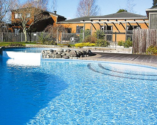 A scenic outdoor swimming pool alongside multiple units.