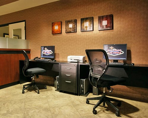 A common room with two computers and a printer.