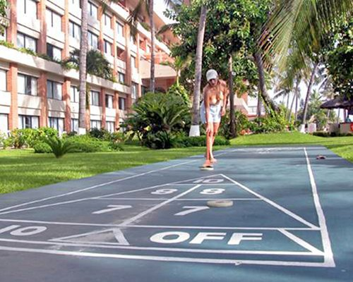 An outdoor shuffleboard alongside the resort.
