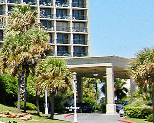 A scenic exterior view of San Luis Condominiums.