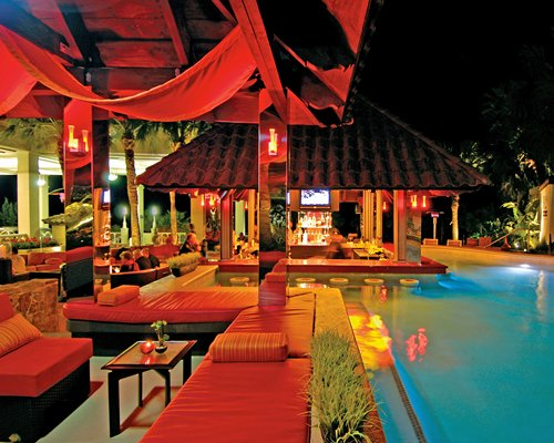 A swim up bar at night.