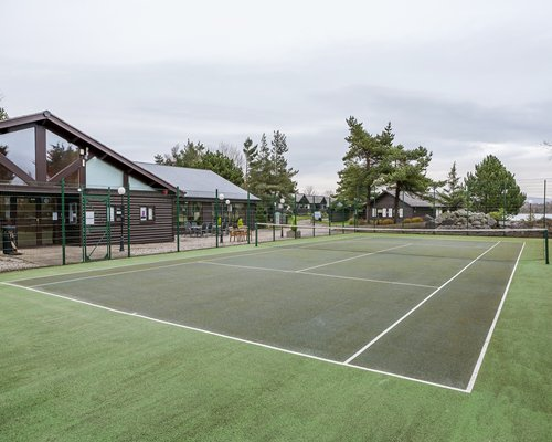 Outdoor tennis court at Pine Lake Resort.