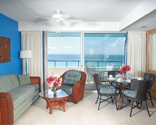 A well furnished open plan living and dining area with the ocean view.