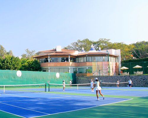 View of outdoor tennis courts alongside the Coral Cuernavaca Resort & Spa.