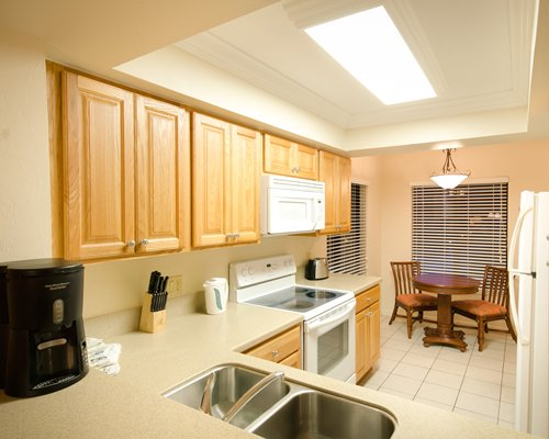 An open plan kitchen with dining area.