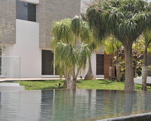 A landscape view of a pond alongside resort u
