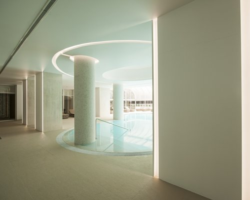 An indoor pool with an outdoor view.