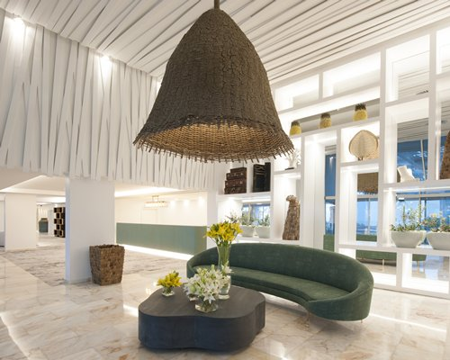 View of the resort lobby with a chandelier al