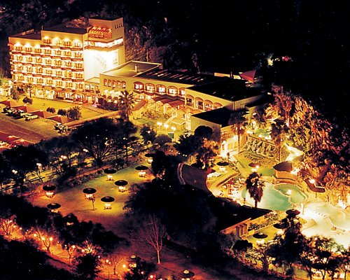 An aerial view of the Avalon Springs resort at night.