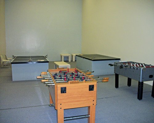 An indoor recreational area with a foosball table.