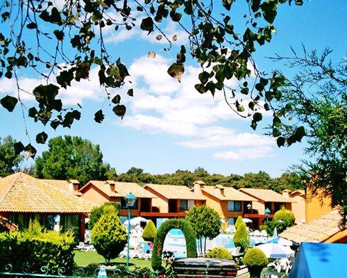 An exterior resort units alongside a swimming pool.