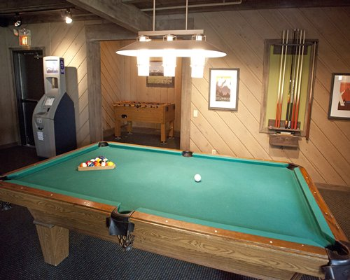 Indoor recreation room with pool table and foosball.