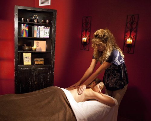 A woman enjoying a massage in an indoor spa.