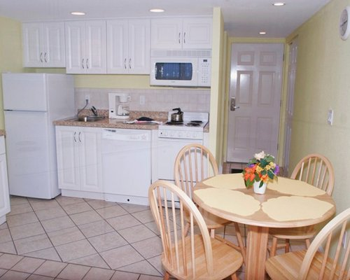 An open plan kitchen with a dining area.