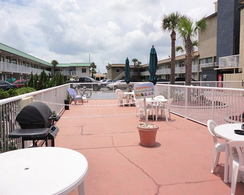 An outdoor patio alongside the resort units.