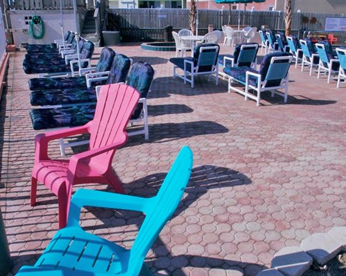 View of chaise lounge chairs and patio furniture.