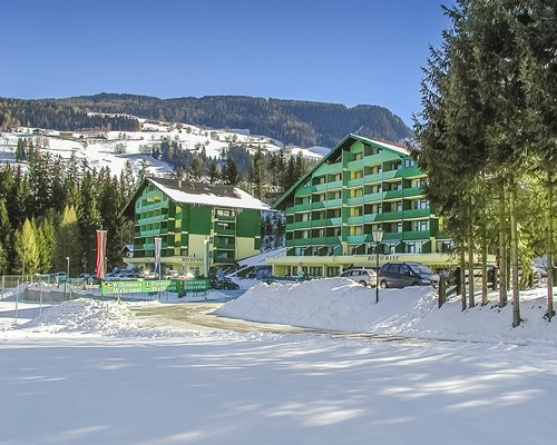 Exterior view of the Alpine Club covered in snow.