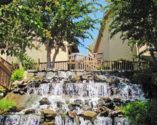 Scenic view of a waterfall alongside the resort unit.