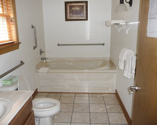 Bathtub and shower with closed vanity sink.