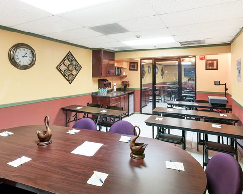 A well furnished indoor dining area with multiple dining tables.