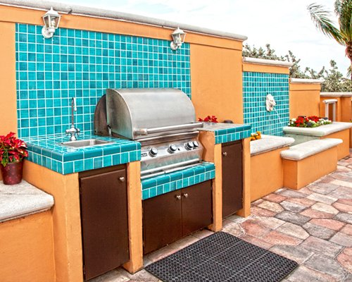 Outdoor picnic area with barbecue grill.