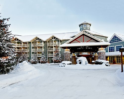 An exterior view of the Birchcliff Villas At Deerhurst Resort covered in snow.
