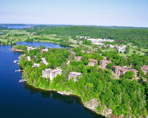 Exterior view of Birchcliff Villas At Deerhurst Resort surrounded by the lake.