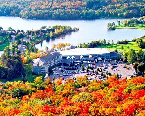 Scenic exterior view of Birchcliff Villas At Deerhurst Resort during fall alongside the lake.