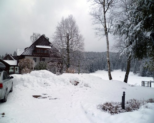 Exterior view of the Erlenbruck covered in snow.