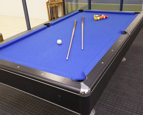 Indoor recreation room with a pool table.