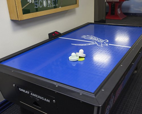 Indoor recreation room with air hockey table.