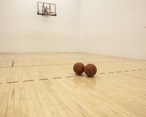 An indoor recreational room with a basketball court.