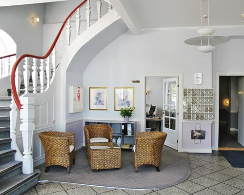 A well furnished living room alongside a staircase.