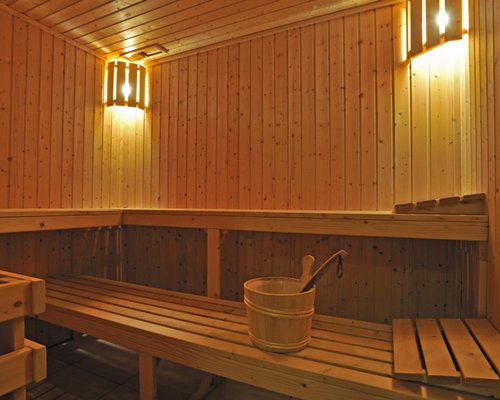 An outdoor tennis court alongside trees.
