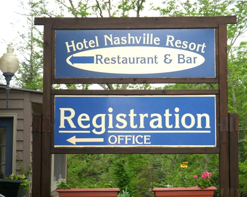 A signboard of the Hotel Nashville Resort restaurant bar and registration office.