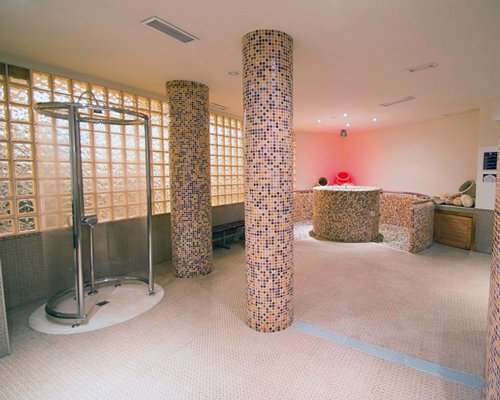 A well furnished indoor room with a stand up shower.