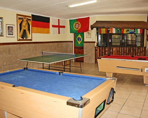 An indoor recreational room with pool tables and ping pong.