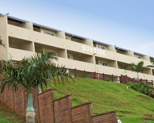 Scenic exterior view of Suntide Illovo Sands with multiple balconies.