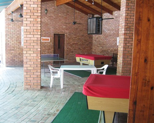 A recreational area with pool tables and ping pong.