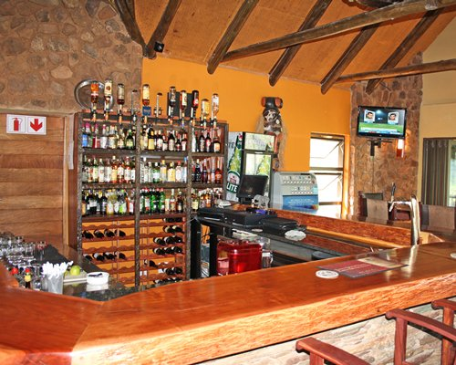 A well equipped bar with television.