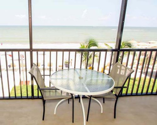 A balcony with patio furniture overlooking the Gulf of Mexico.