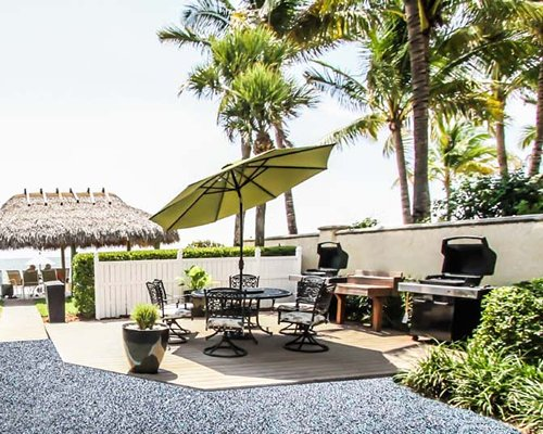 An outdoor dining area with barbecue grills.